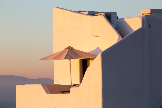 Oooops, late again. Came back from the Greek Isle with a lousy cold so I'll use that as the excuse to be late with posting. Warm golden glow of sunset on the building next to our hotel in Finikia, Santorini.