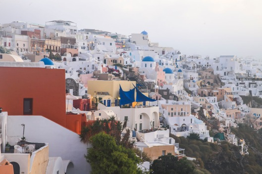Although the glossy tourist brochures would have us believe that the Greek Isles are all white buildings with blue domes and doors there are many other colours mixed in amongst the buildings as people try to make a distinction between themselves and the next place. Still it's overall a white and blue effect.
