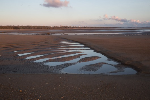 A long view of the Other Beach at Tannum Sands with big ripple-like patterns in the sand.